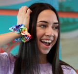 Girl with Flavor Your Life Scrunchie on her arm