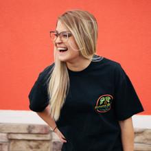girl smiling wearing neon sign tee