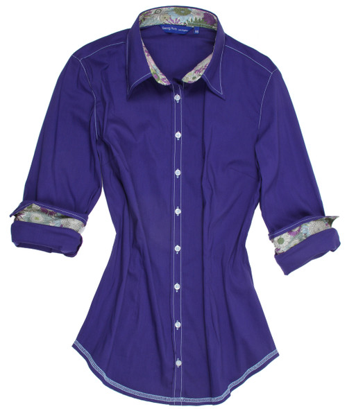 Easy comfort and trendy style meet in this super soft vivid purple stretch blouse with Liberty of London floral contrast in shades of purple, green and yellow in collar & cuffs. All seams are finished with contrast stitching in white.