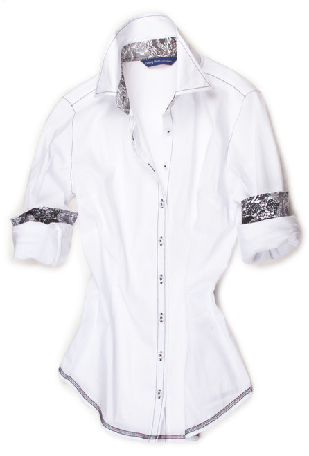 Heavenly Stretch in crisp White. Inner collar stand and cuffs are embellished with a Liberty of London Charcoal, black, grey and white floral print. All seams are stitched in charcoal with a zig zag finish hem.