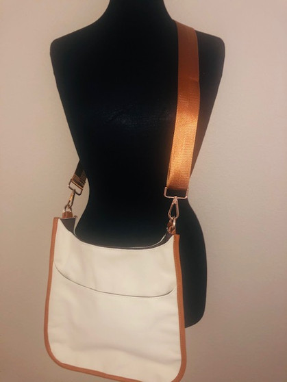 Cream with camel piping and a camel strap