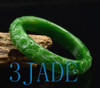 green jade bangle with carved flower