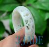55.5mm carved jade bangle