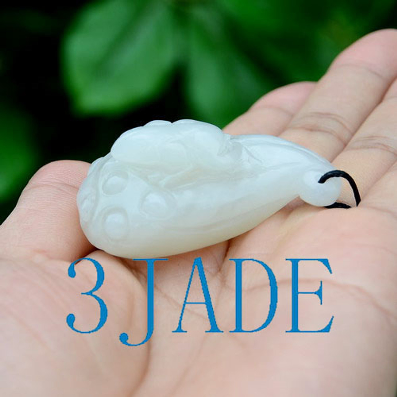 hand carved jade lotus seed pod with frog