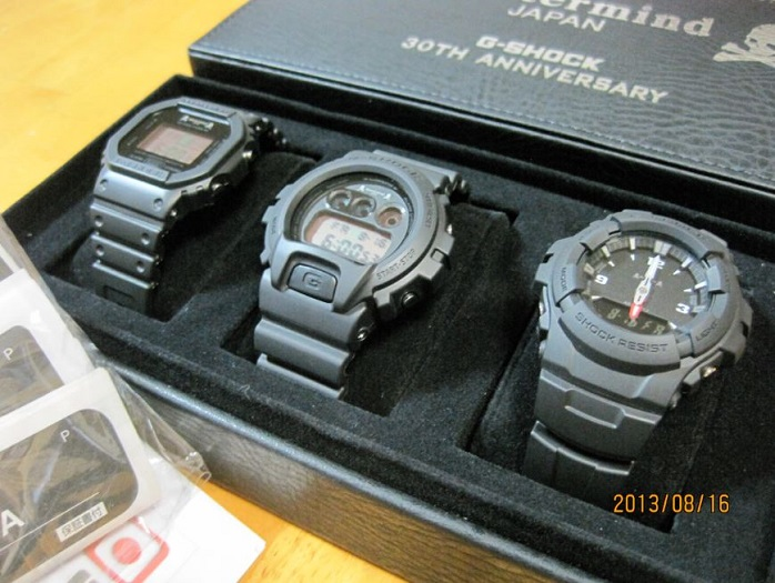 Three black G-Shock watches in a box