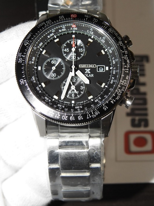 close-up of black face on silver Seiko watch