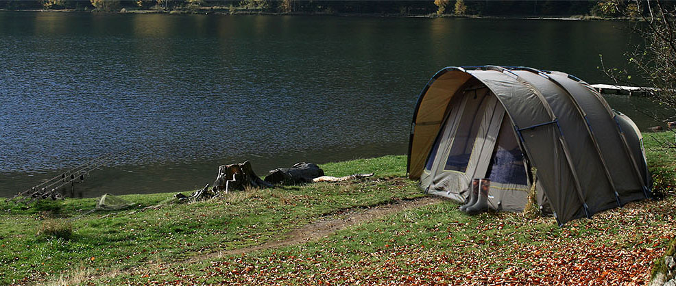 Global Outdoors: Tent by a lake