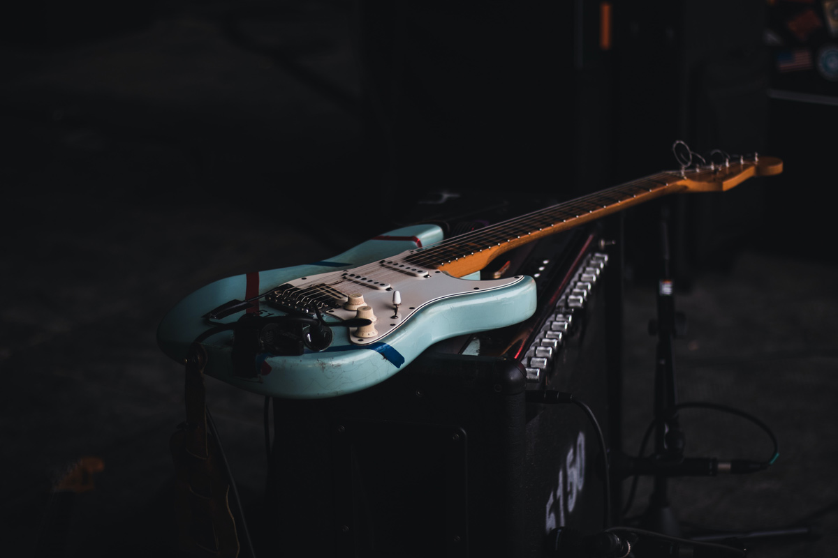 Fender guitar sitting on an amp