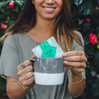 happy girl smiling with a cup of neurogan cbd tea