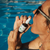 A Woman in sunglasses using the CBD Spray 2000mg in the pool