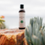 CBD massage oil product on a rock surface in nature