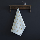 Organic cotton tea towel covered in yellow labradors from Sweet William Designs.