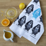 "100% cotton Bassett hound tea towel from British designer Lucky Lobster Art with the words ""It wasn't me""."
