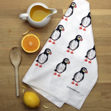 Puffin tea towel with design from the original lino print artwork from Lucky Lobster Art in England.