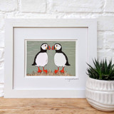 Two Cheeky Puffins framed print taken from the original lino print artwork from Lucky Lobster Art.