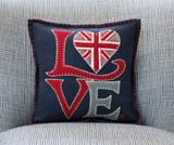 Hand embroidered Union Jack Heart pillow from British designer Jan Constantine.