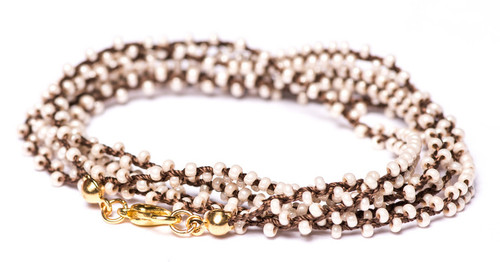 """32"""" braided brown silk thread necklace with charming white pearl seed beads. Gold plated clasp."""