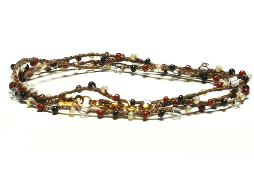 """16"""" braided chestnut brown silk thread necklace with clear 2-cut hex, black and burgandy seed beads and gold plated clasp"""
