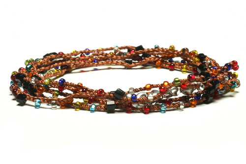 """32"""" braided cognac brown silk thread necklace with black 2-cut hex, transparent turquoise, teal, yellow, blue, orange, red, and clear seed beads and silver plated clasp"""