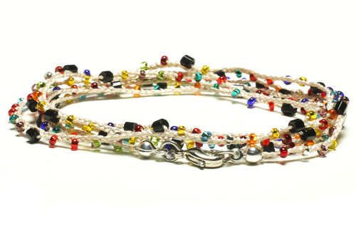 """32"""" braided ecru silk thread necklace with black 2-cut hex, transparent green, lilac, red, teal, purple, blue, yellow orange, and clear seed beads and silver plated clasp"""