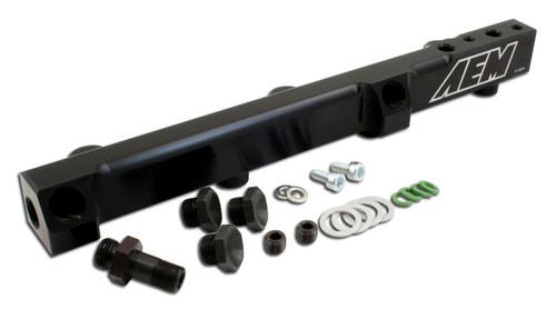 """AEM High Volume Fuel Rail. Black. Honda F22A1, F22A4, F22A6, H22A1, H22A4 & H23A1 Supports fuel flow up to 1,000 horsepower No additional parts required for installation - installs with factory fuel line using supplied fitting Pre-tapped for -6 AN or 9/16""""x 18 fittings Specifically engineered for each application Works with factory fuel line or custom fuel lines 1/2 inch bore dampens backpressure pulses from larger fuel injectors 1/8 NPT port included for nitrous pick up or fuel pressure gauge Comprehensive installation instructions, hardware, fittings and injector O-rings included CNC Machined from billet aluminum Black anodizing with laser engraving Complete hardware, fittings and injector O-rings included Manufactured and assembled in the USA"""