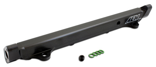 """AEM High Volume Fuel Rail. Black. Mitsubishi 4G63 Supports fuel flow up to 1,000 horsepower No additional parts required for installation - installs with factory fuel line using supplied fitting Pre-tapped for -6 AN or 9/16""""x 18 fittings Specifically engineered for each application Works with factory fuel line or custom fuel lines 1/2 inch bore dampens backpressure pulses from larger fuel injectors 1/8 NPT port included for nitrous pick up or fuel pressure gauge Comprehensive installation instructions, hardware, fittings and injector O-rings included CNC Machined from billet aluminum Black anodizing with laser engraving Complete hardware, fittings and injector O-rings included Manufactured and assembled in the USA"""