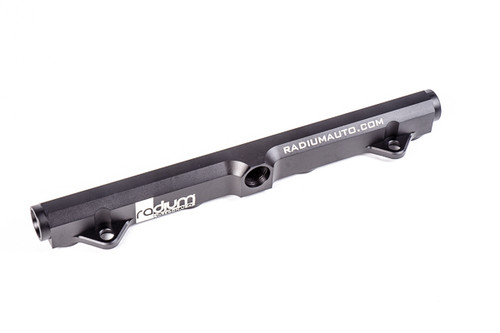 """Radium Fuel Rail Kit, EVO 8-9 Manufactured with a large 0.69"""" internal bore, the fuel rail can support all necessary engine power requirements.. The rail is CNC machined from solid 6061 aluminum, bright-dipped anodized and laser etched for a high quality surface finish.It is compatible with all fuel types including popular alcohol mixtures such as E85. Unlike most aftermarket EVO 8-9 fuel rails on the market, the Radium fuel rail eliminates the OEM 2 bolt inlet flange which uses a restrictive 0.22"""" (5.7mm) orifice. All three ports use -8AN ORB threads. This option includes only the basic fuel rail as shown in the picture below. All fittings must be purchased separately. This option is perfect for installers building a custom fuel system."""