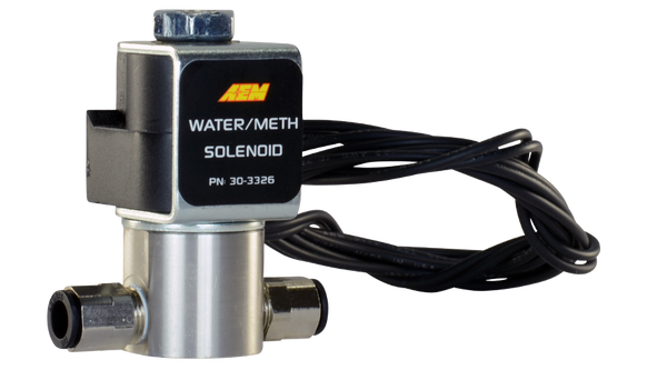 """AEM's stainless steel Water/Methanol Injection Solenoid (PN 30-3326) eliminates any chance of water/methanol flow into the inlet when the WMI system is not engaged. This affordable water/methanol injection accessory features high flow capability (3,600cc/min) and an impressively low current draw of only 0.75A that does not require the use of an additional relay.  The valve body features include 1/8"""" NPT ports with included push-to-lock ¼"""" hose fittings for easy connection and EPDM seals that stand up to corrosion for years of reliable use. It's an inexpensive insurance policy to protect your high performance engine regardless of the brand of water/methanol injection system you are using!  Features:  High flow rating (3600 cc/min @ 150 psi) Low current draw (0.75A @ 13.5V) No additional relay required Standard 1/8""""- 27 NPT inlet/outlet with included ¼"""" push-to-lock hose fittings for easy installation Fast response time Tested to 200 PSI Stainless steel enclosure and internals with EPDM seals for corrosion resistance Flying leads simplify connection with user desired connector"""