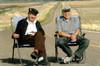 Juan and Angel Delgadillo sitting on Route 66 Seligman, Arizona Postcard