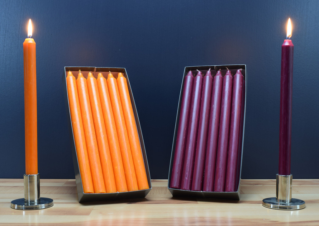 """Set of 12 Kiri 12"""" Dinner Candle Tapers. Orange taper candles and plum taper candles."""
