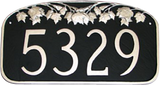 Metal Address Plaque shown here with a black background and raised silver numbers, border and maple leaf design.