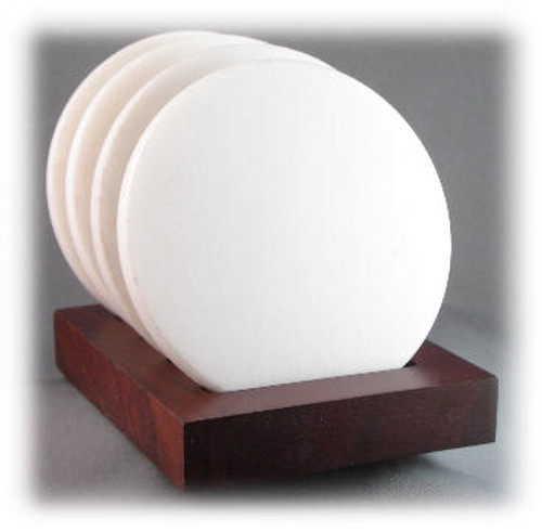Four (4), White Marble,  4 inch Diameter x 8mm Coasters  Mounted in Mahogany Base