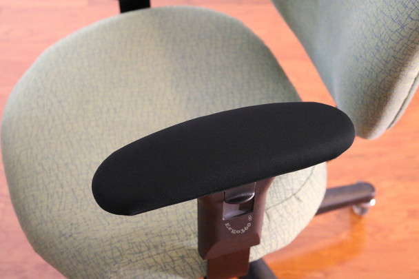 "Ergo360 Fitted Neoprene Armrest Covers Installed Over 12"" Chair Arm Pads"