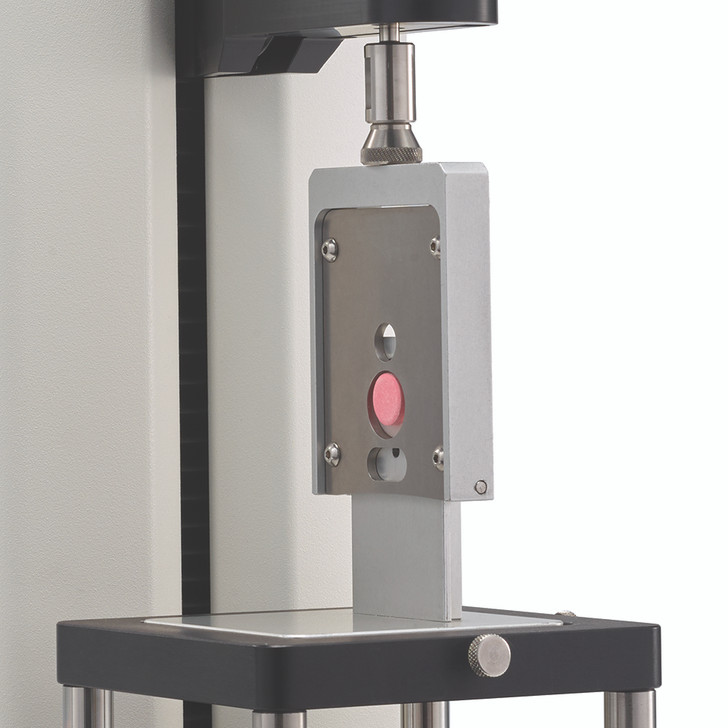 Measure shear strength of two-part tablet or capsule using guillotine blade.