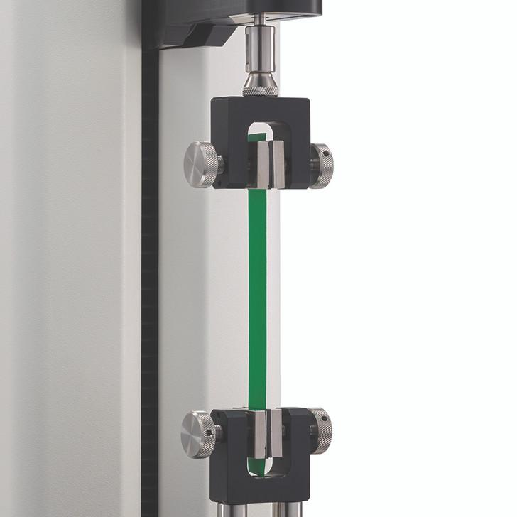 Fixation à double prise pour les essais de traction de films minces ou l'intégrité des joints d'étanchéité pour les emballages.