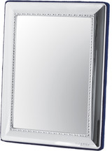 Egg and bead pattern table mirror with velvet back. Stands vertically or horizontally