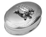 Oval hinged pillbox with moving turtle