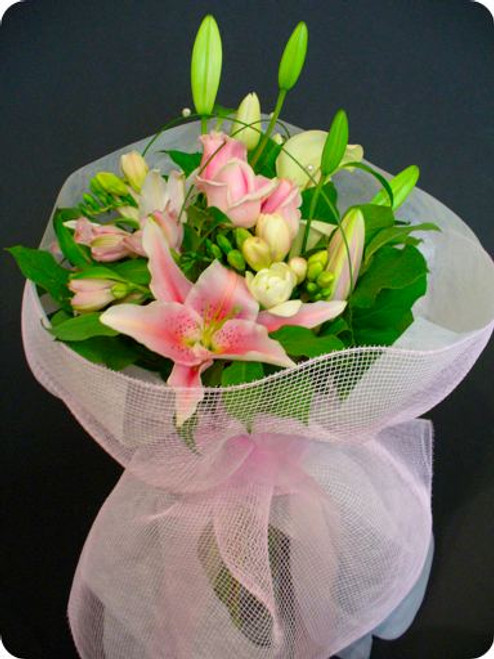 Bouquet of pretty pink and white flowers beautifully arranged with pink and white wrapping and organza bow.
