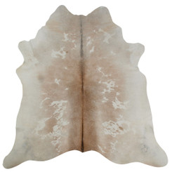Pale brown and white cowhide rug
