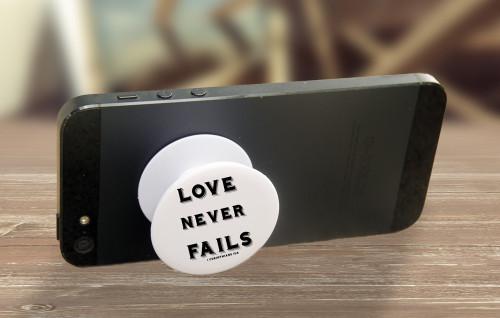 """Love never Fails"" Pop-Up Phone Holder"