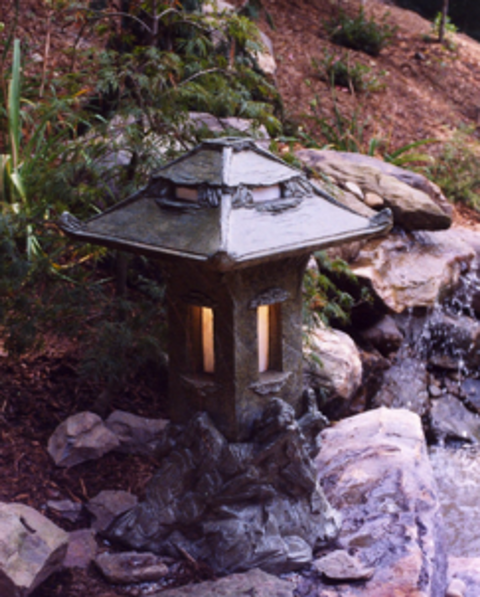 Cement outdoor lantern,  • 3 Piece Lantern (base, light house, top) • Made of Glass Fiber Reinforced Concrete (GFRC) • Multiple colors available (comes w. stained glass) An unprecedented functional design with stained glass windows in both light house & top. A must for Japanese gardens! Not the usual Stone Pagoda!