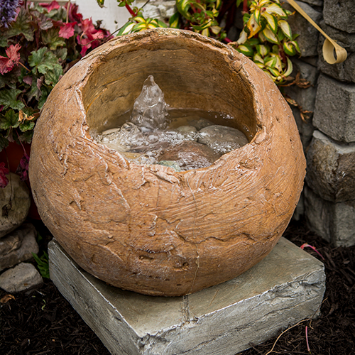 Stone fountain, indoor and outdoor water fountain, Contemporary Oval Fountain - Hand Sculpted, One of our best sellers this compact fountain has virtually no splash. Small stone fountain that will fit in that empty corner on the deck!! The enclosed sphere creates a wonderful sound of rustling water. Indoor / Outdoor feature, Great for decks and patios!