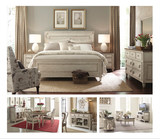 Reminiscent of a cottage in the European countryside, the Southbury furniture package is both charming and elegant.   Its inspiration comes from the gracefully aged painted antiques of a previous era. The personality of Southbury with oak veneers is captured in the finish where handwork and an artistic eye create the Parchment finish on the fronts and end panels while the tops are treated to a contrasting fossil tone finish.   Design elements from French and Italian influences not only add character, they also make the furniture right at home in both traditional and casual bedroom, dining room, or living room spaces.