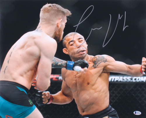 Conor McGregor Autographed UFC 16x20 Photo (Beckett COA)