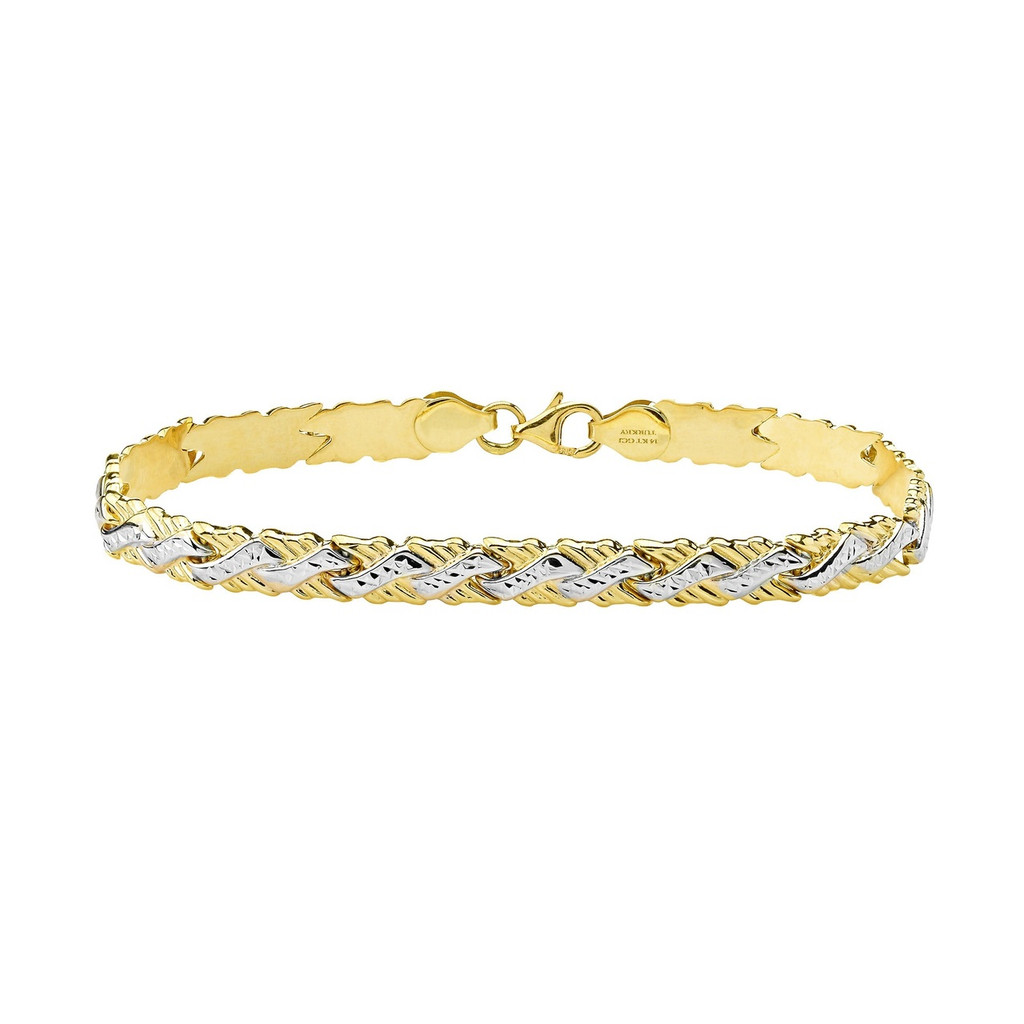 14Kt White Gold Textured and High Polish Twisted Bangle .