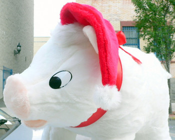Big Plush brand large stuffed Christmas Pig dressed in red Santa cap made in the USA.