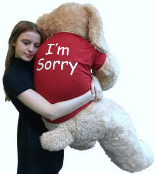 Say I'm Sorry With Giant Stuffed Puppy Dog 5 Foot Soft Tan Wears T shirt that says I'M SORRY