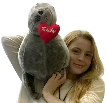 Big stuffed seal lion is custom personalized with your text on it's heart