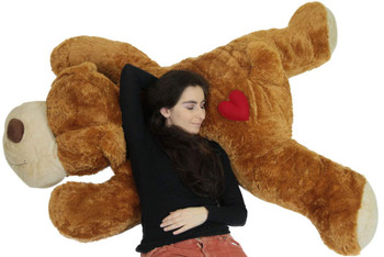 Giant stuffed dog with heart pillow on it's butt