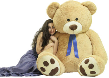 6 foot teddy bear hand-stuffed in America with very soft polyester stuffing weighs 22 pounds and is as soft as a pillow.